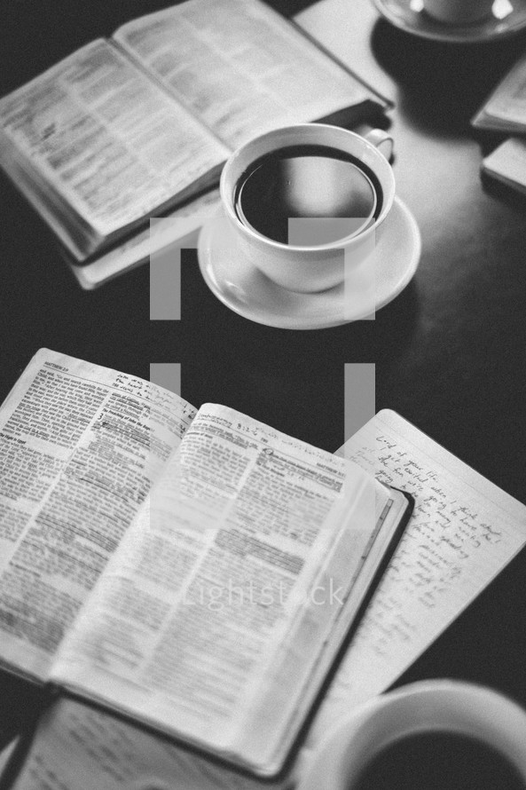 open Bibles and a coffee mug