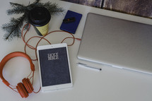 headphones, iPad, Holy Bible, laptop, journal, coffee cup, pine boughs