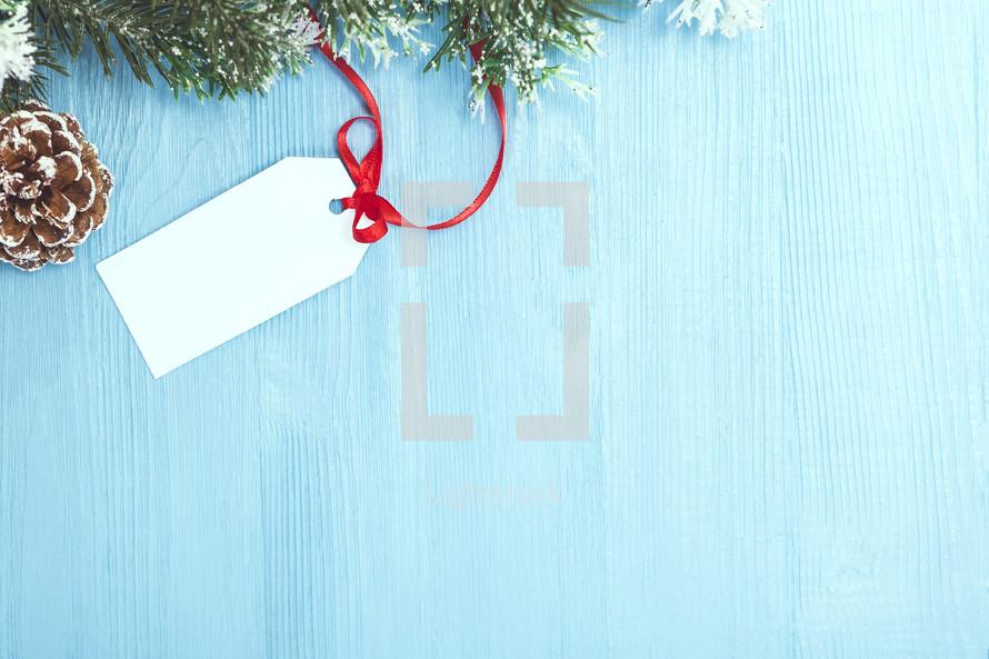 Christmas greenery and gift tag
