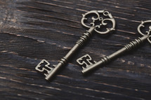 skeleton key on wood background