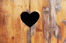 Heart shape in wood background