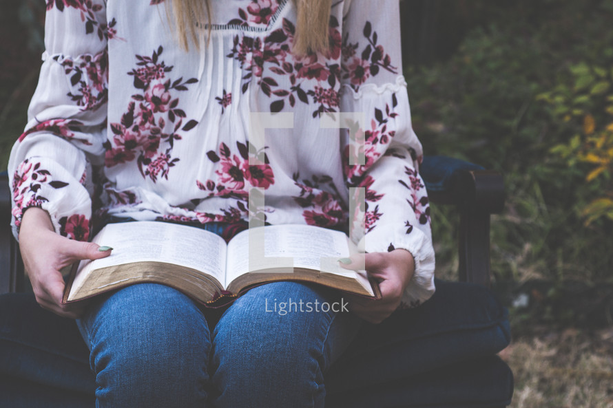 girl reading a Bible in her lap