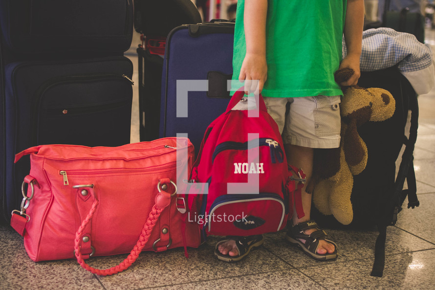 child carrying bags and luggage