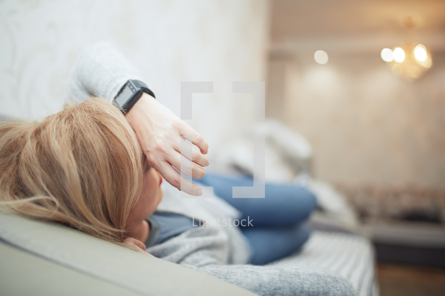 an exhausted woman on a couch