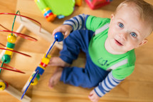 an infant playing with toys in a playroom