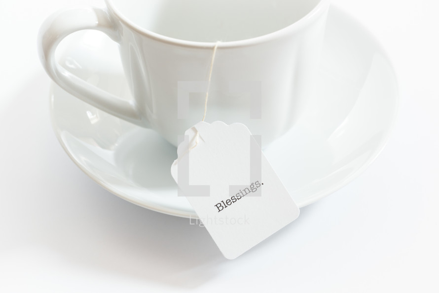 tea cup with the word blessings on the tea bag