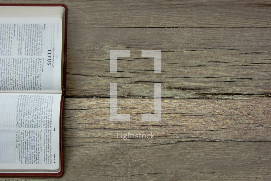 A Bible opened to Titus