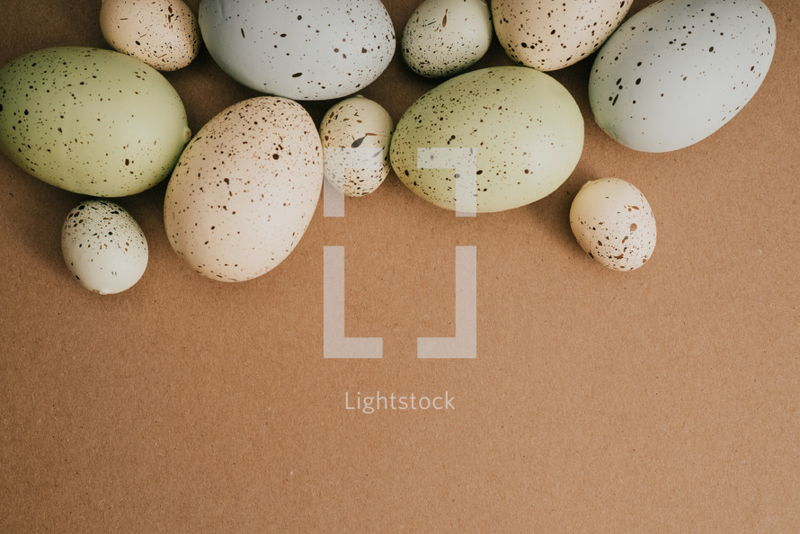 speckled Easter eggs on a brown background,