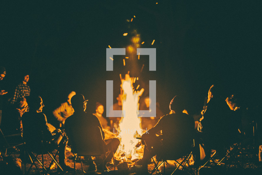 sitting around a campfire