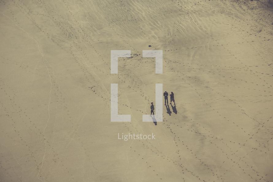 men walking through a desert