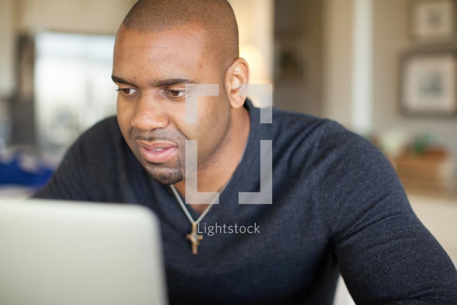 Man looking at a computer monitor.