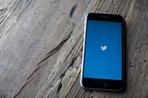 Twitter app opened on a cellphone screen