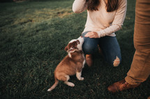 couple with a new puppy