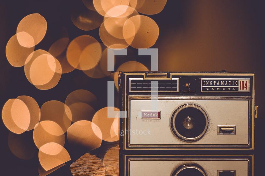 vintage camera on bokeh lights