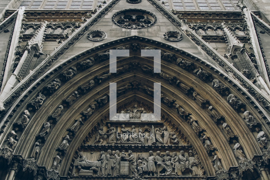 detailed engravings and carvings on Notre Dame