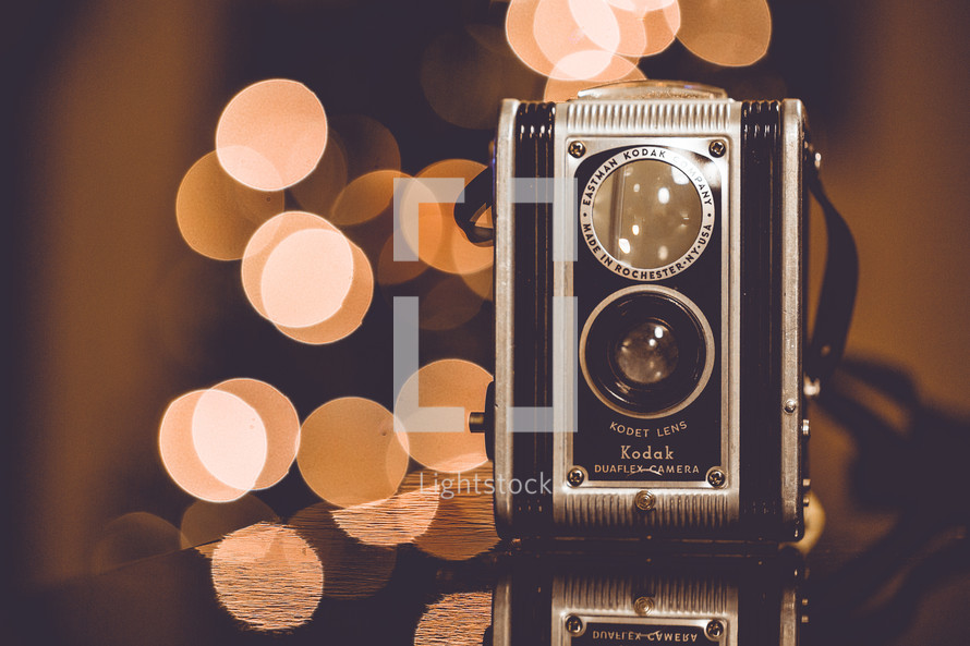 vintage camera and bokeh lights