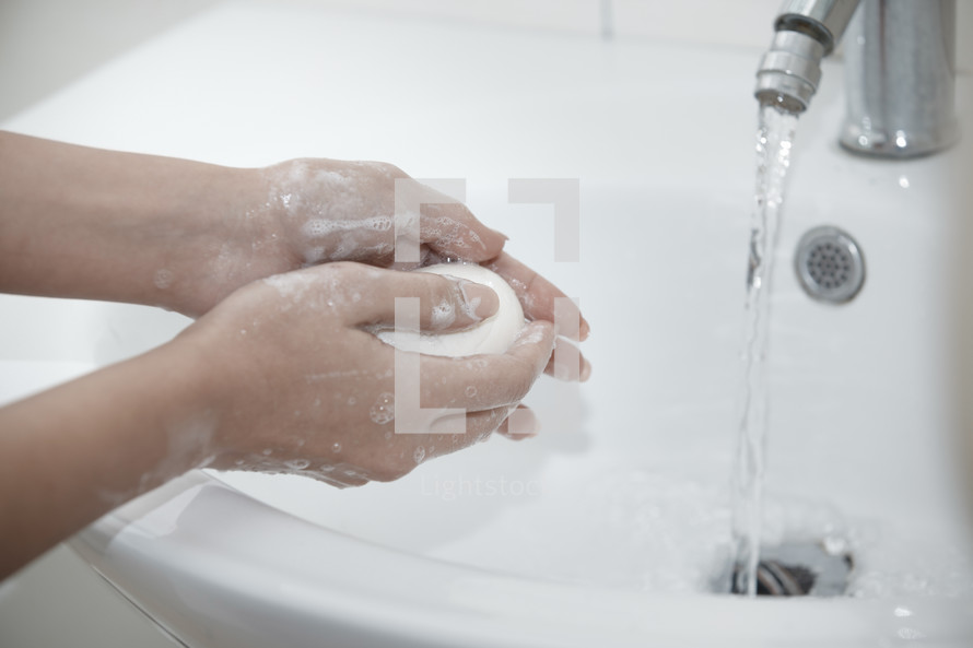 washing hands in a sink