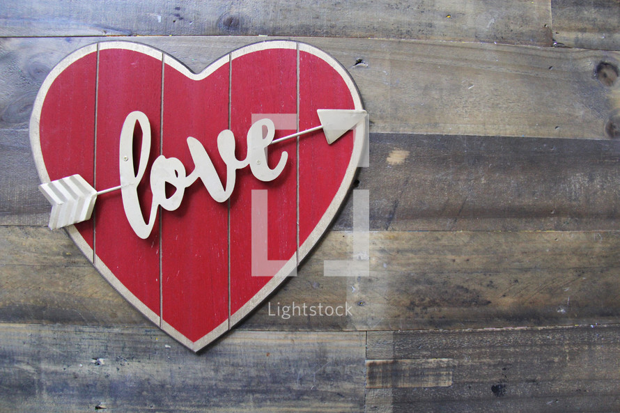 love heart sign on wood background