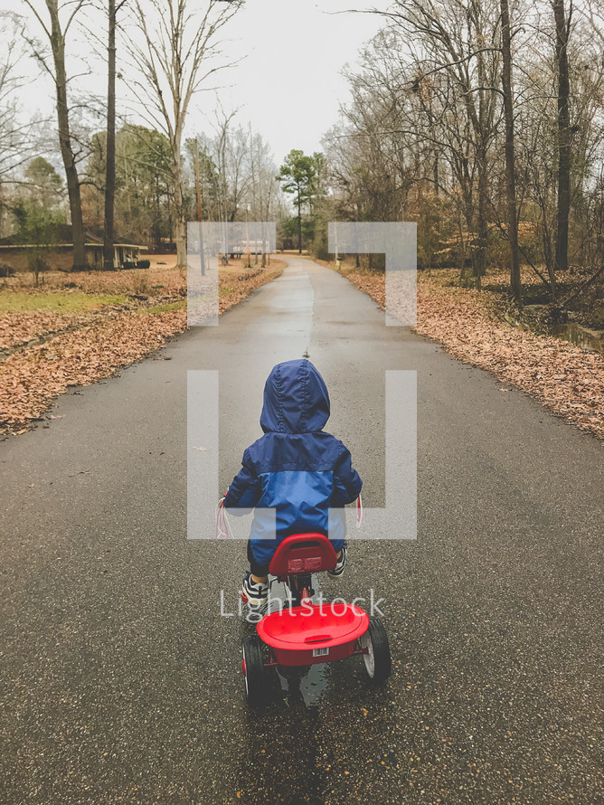 toddler riding a tricycle