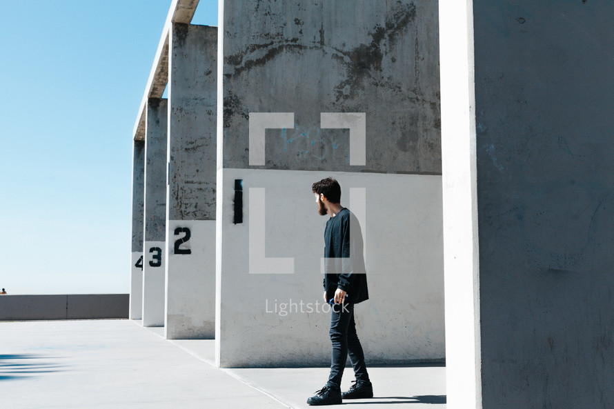 a man standing in front of numbered walls