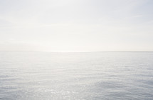View over the sea, ocean. Beautiful calm water, bright light.