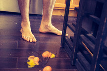 bare feet and a messy kitchen floor