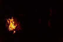 flames from a fire in darkness