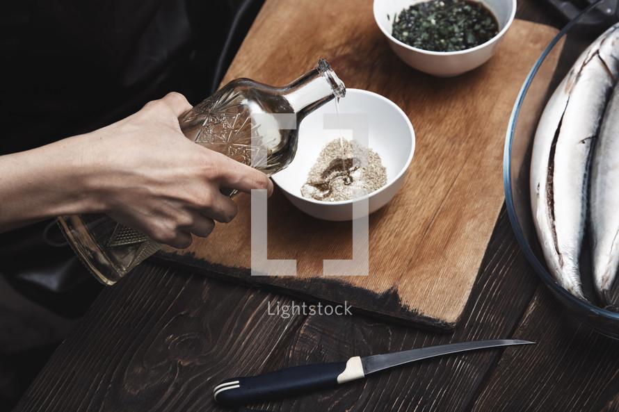 Woman preparing marinade for fish