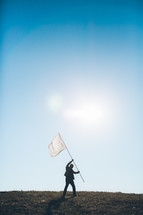 business man holding a white flag - surrendering