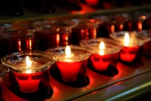 Beautiful red glowing candles at a Christmas Eve service at a local house of worship church service.