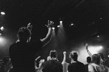 worshipers standing with hands raised