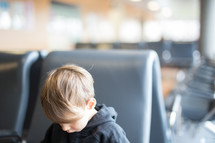 a boy child in a waiting area