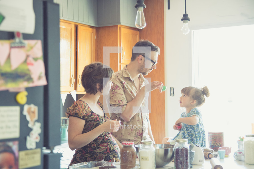 a family together in a kitchen