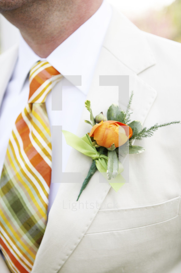 boutonniere on groom at wedding