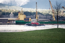 barge and tug boat on a river