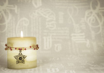 Christmas candle with star and jewels, cream text background