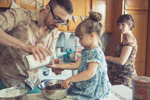 a family baking together in the kitchen
