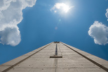 looking up at the top of a bell tower and blue sky