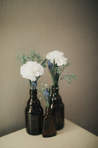 flowers in a brown bottle vases