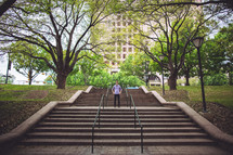 man standing on outdoor stairs