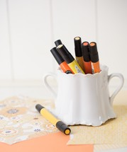 orange and yellow paint pens