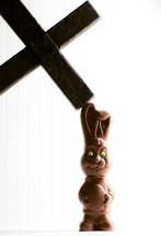 cross smashing a chocolate bunny
