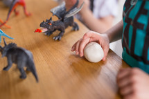 kids playing with dragons and dinosaurs