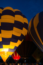 A gathering of people at a hot air balloon festival.