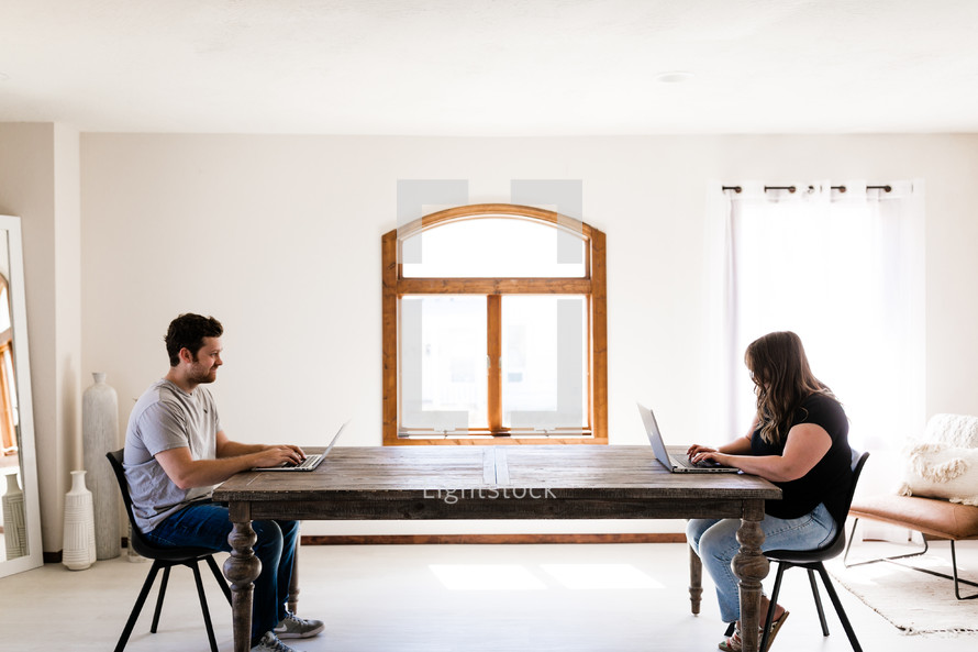 man and woman working from home