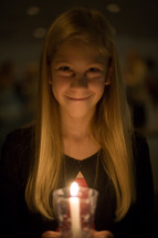 girl child at a Christmas Eve service