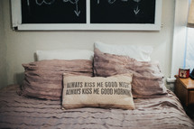 always kiss me good night, always kiss me good morning throw pillow on a bed