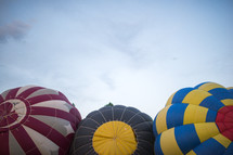 The top of three hot air balloons.