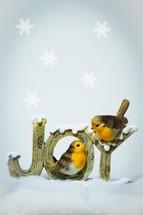 JOY figurine with birds