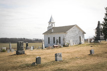 old rural church surrounded by a cemetery